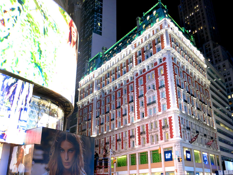The Knickerbocker exterior, lit by massive screens in Times Square - Photo by Hideaway Report editor