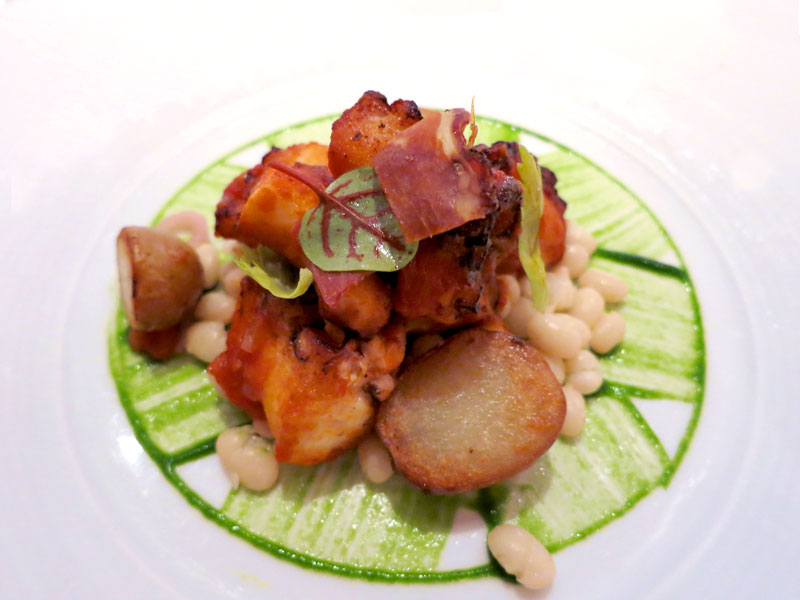 Octopus with sofrito, white beans and Serrano ham at <em>Aureole</em> - Photo by Hideaway Report editor