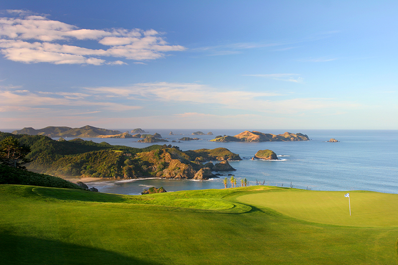Hole 16 backdropped by the Cavalli Islands at Kauri Cliffs, Bay of Islands