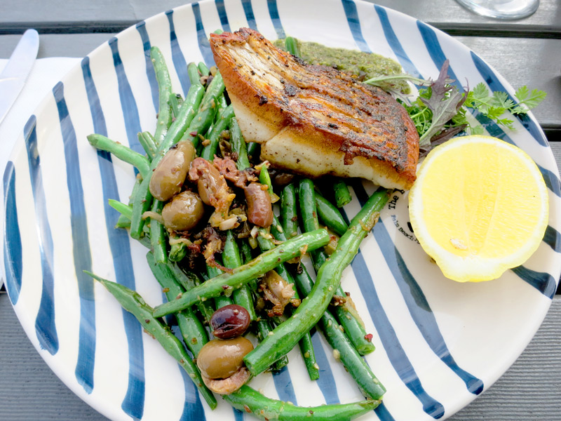 Crispy-skinned <i>terakihi</i> fish with al dente green beans, garlic, shallots and cumin-spiked pesto at <i>The Boathouse</i> - Photo by Hideaway Report editor
