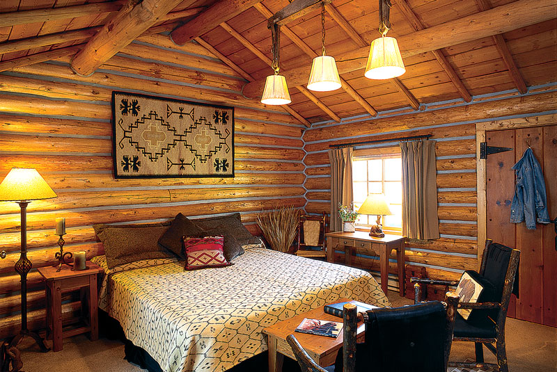 Traditional Cabin bedroom at Firehole Ranch