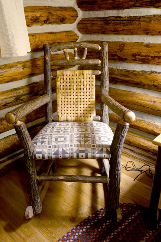 Comfortable interiors at Jenny Lake Lodge include furnishings such as this rustic chair