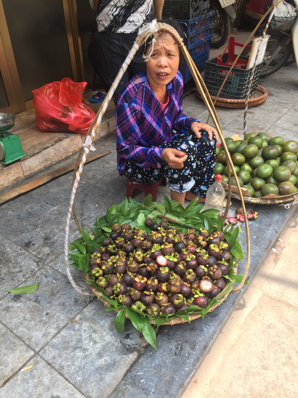 Mangosteen seller on the streets of Hanoi, Vietnam - Kristen Remeza