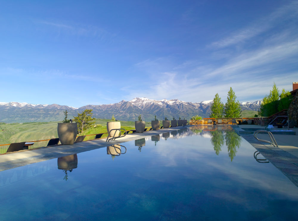 The pool at Amangani with a view of the Snake River Range
