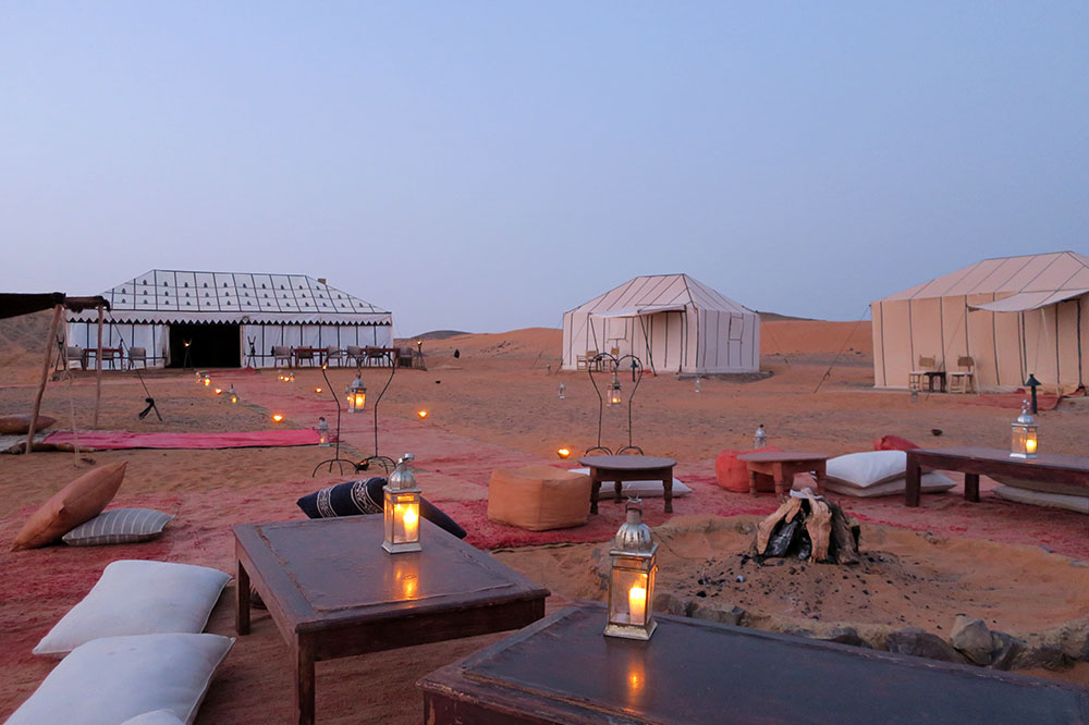 A sitting area near the dining and guest tents at Merzouga Luxury Desert Camps in Merzouga, Morocco