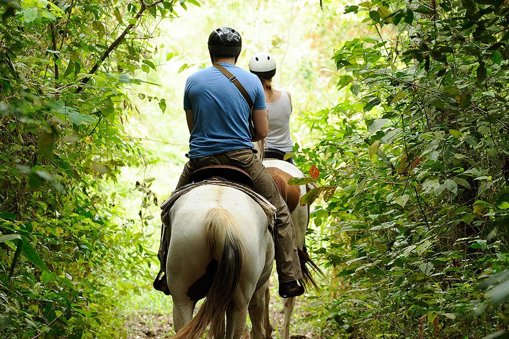 Horseback riding at Chaa Creek Lodge