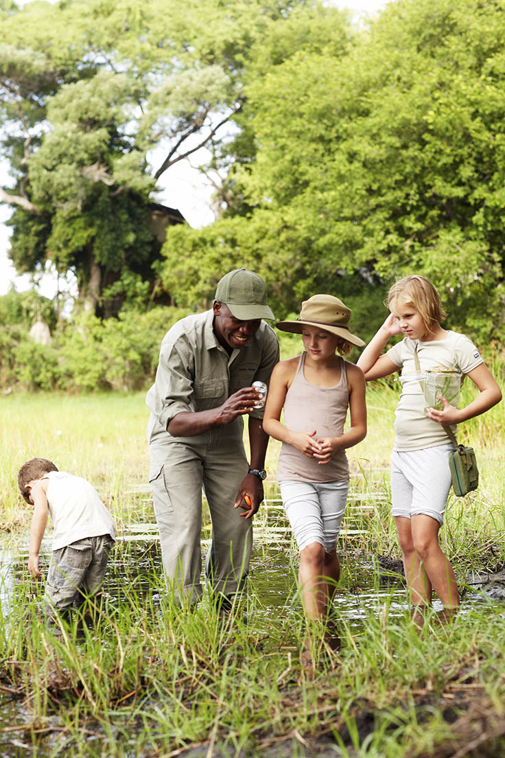 Children discovering African wildlife while on safari. Photo by Mickey Hoyle, courtesy of Wilderness Safaris.