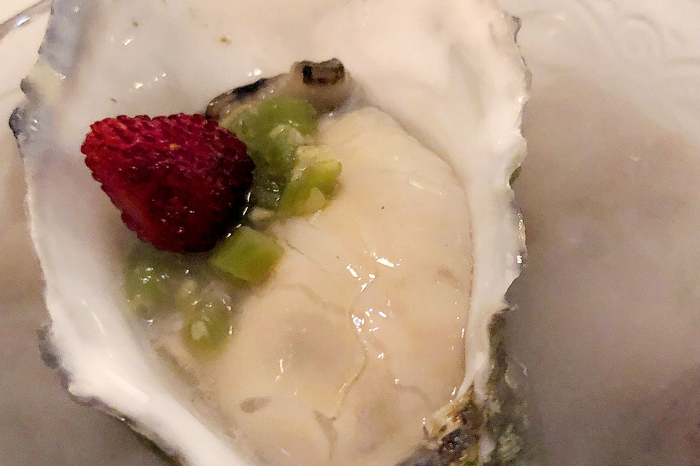 An oyster with raspberry and lime zest from <em>La Candela Restò</em>