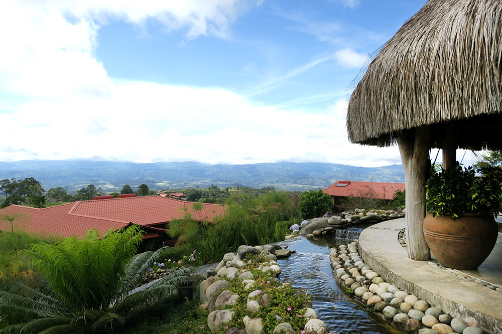 A palapa overlooking casitas and the grounds of Hacienda AltaGracia