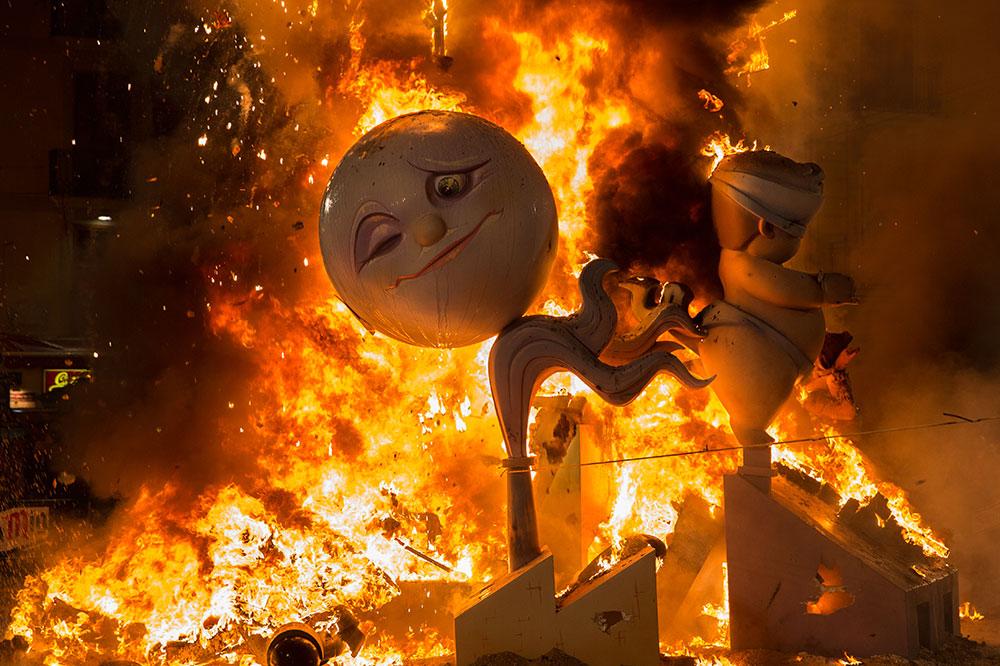 The burning of a papier-mâché falla in Plaza de la Reina during Las Fallas in Valencia, Spain
