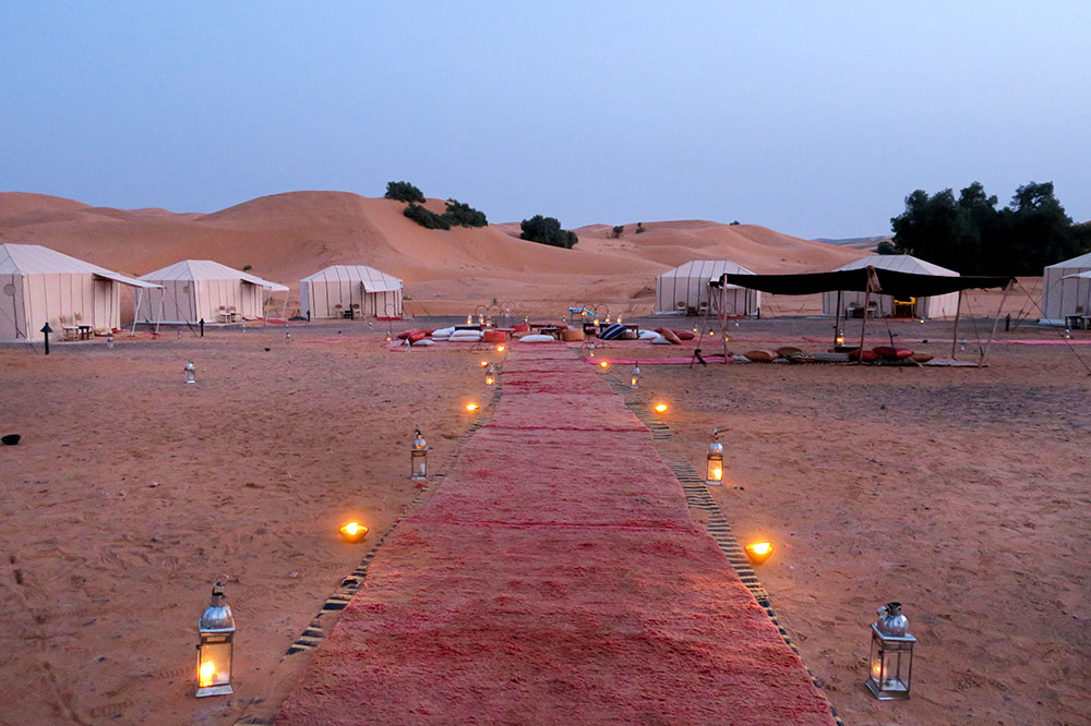 A pathway through the camp at Merzouga Luxury Desert Camps in Merzouga, Morocco