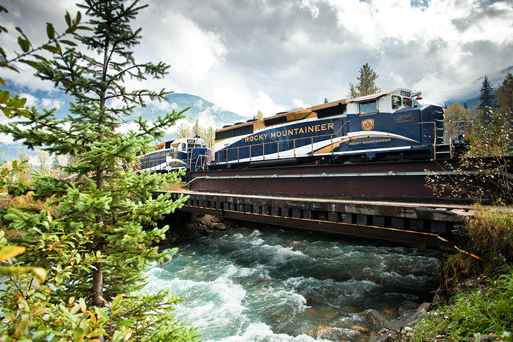 Rocky Mountaineer crosses a river in the wilds of the Canadian Rockies