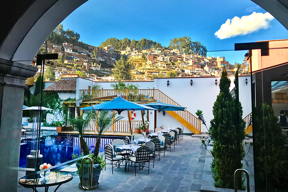 The pool area, with a view of Cusco, at Belmond Palacio Nazarenas - Photo by Hideaway Report editor
