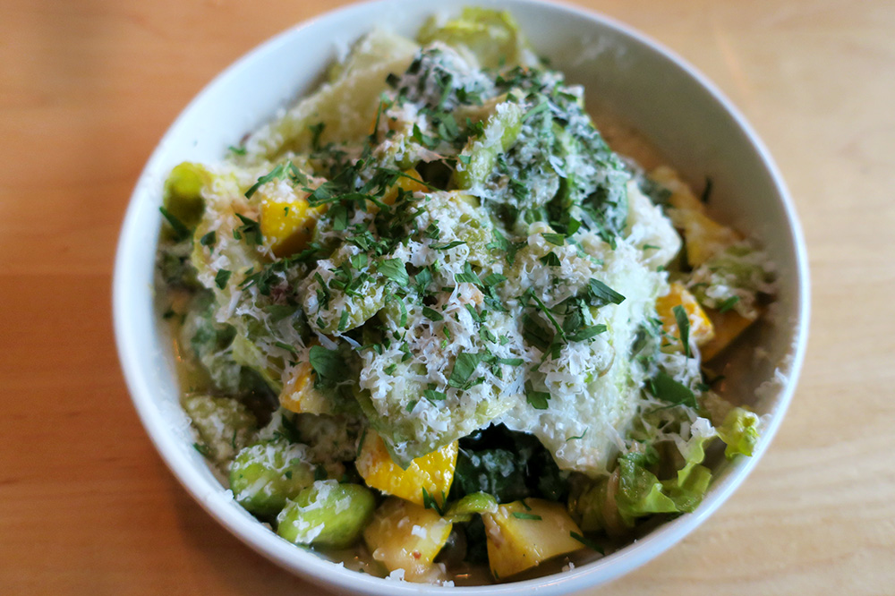 Ragout of fava beans, zucchini, escarole, basil and mint with aged goat cheese and toasted garlic-anchovy vinaigrette from <em>Ox</em> in Portland, Oregon - Photo by Hideaway Report editor