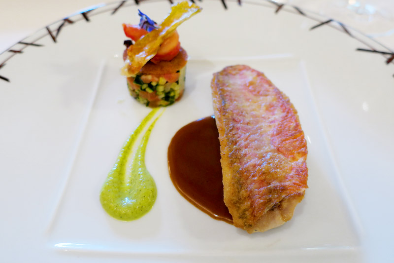 Red mullet with shellfish jus and a ratatouille brunoise at the restaurant at Le Relais Bernard Loiseau - Photo by Hideaway Report editor