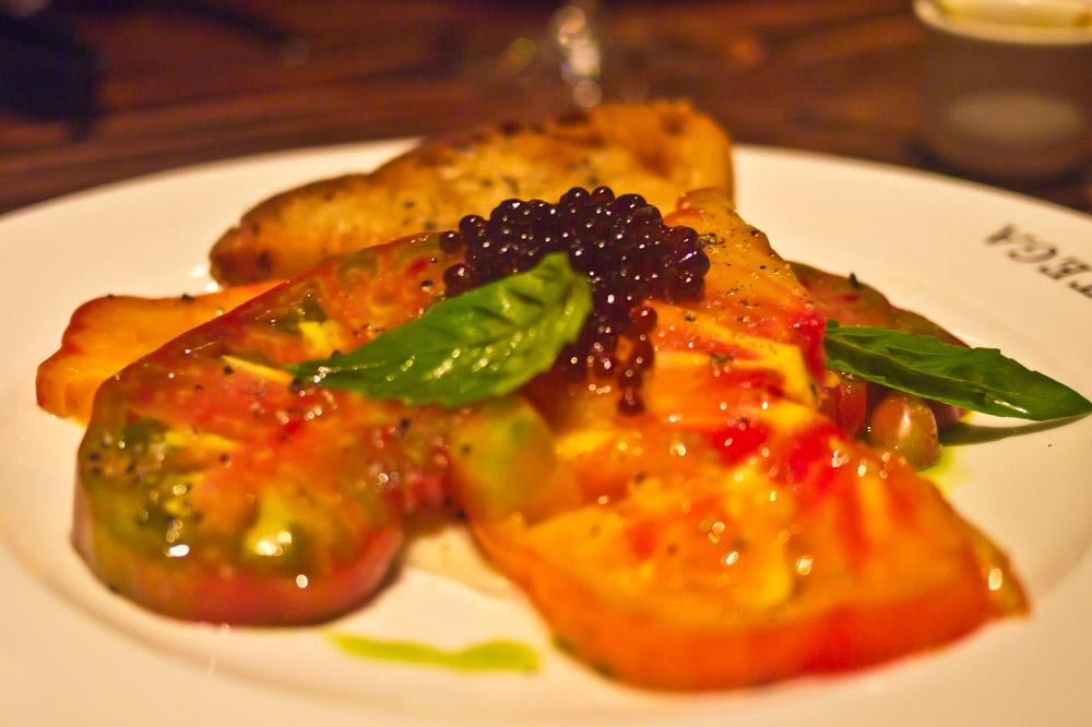"Local heirloom tomatoes, balsamic ""caviar"" and basil oil at <em>Bottega</em> in Yountville, California"
