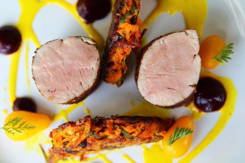 Moroccan-spiced pork tenderloin with a carrot-and-cilantro fritter at <em>Café Beaujolais</em> in Mendocino, California