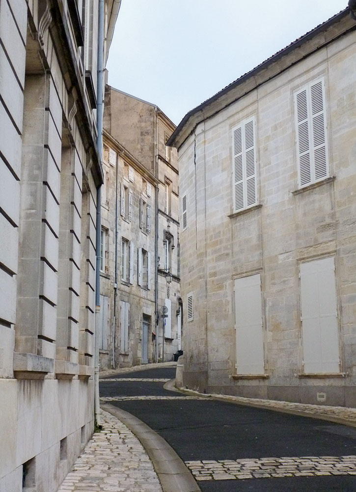 A road in between buildings in Cognac, France - Photo by Hideaway Report editor