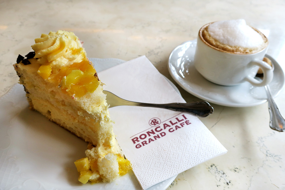 Mango-crème fraiche torte and cappucino from <em>Roncalli Grand Café</em>