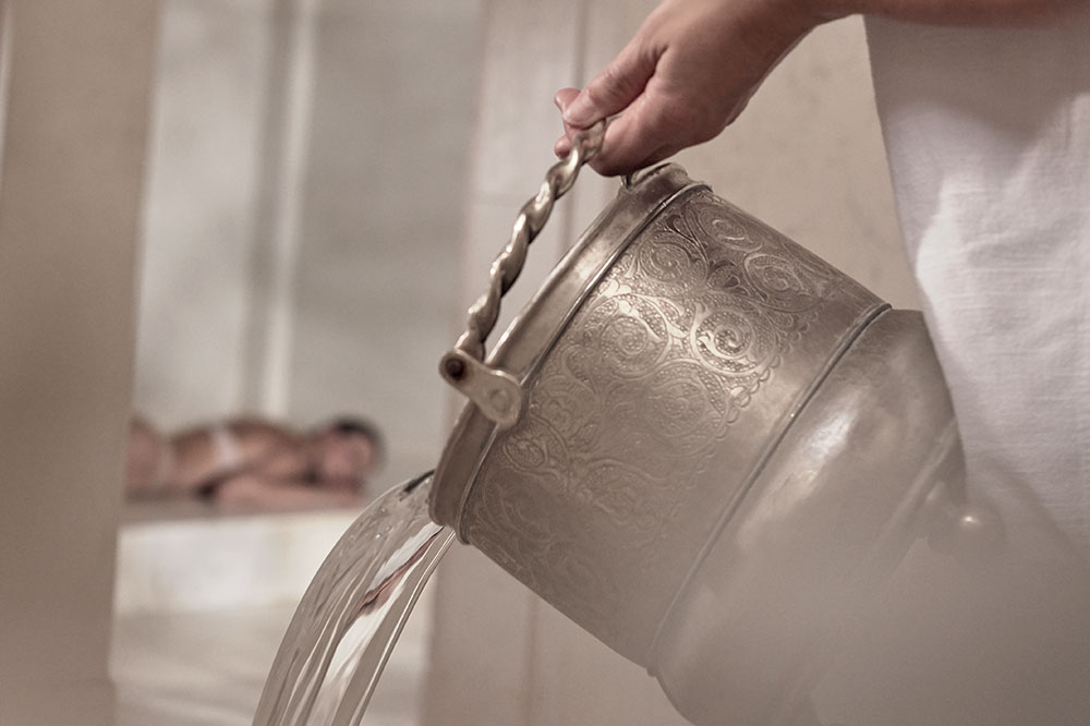 Pouring water for the steam room for the hammam treatment at Royal Mansour in Marrakech