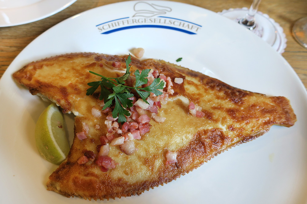 Baltic Sea plaice fried in bacon fat from <em>Schiffergesellschaft</em> in Lübeck, Germany - Photo by Hideaway Report editor