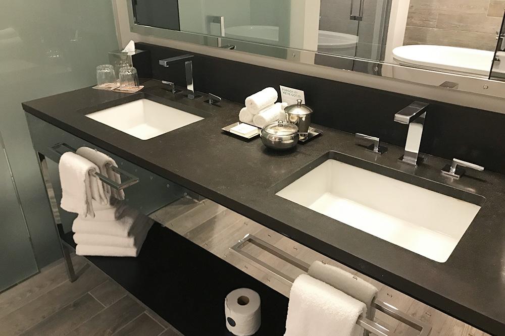 Double sinks in the bath of our Queen Queen Spa Studio at the Hotel Van Zandt in Austin, Texas