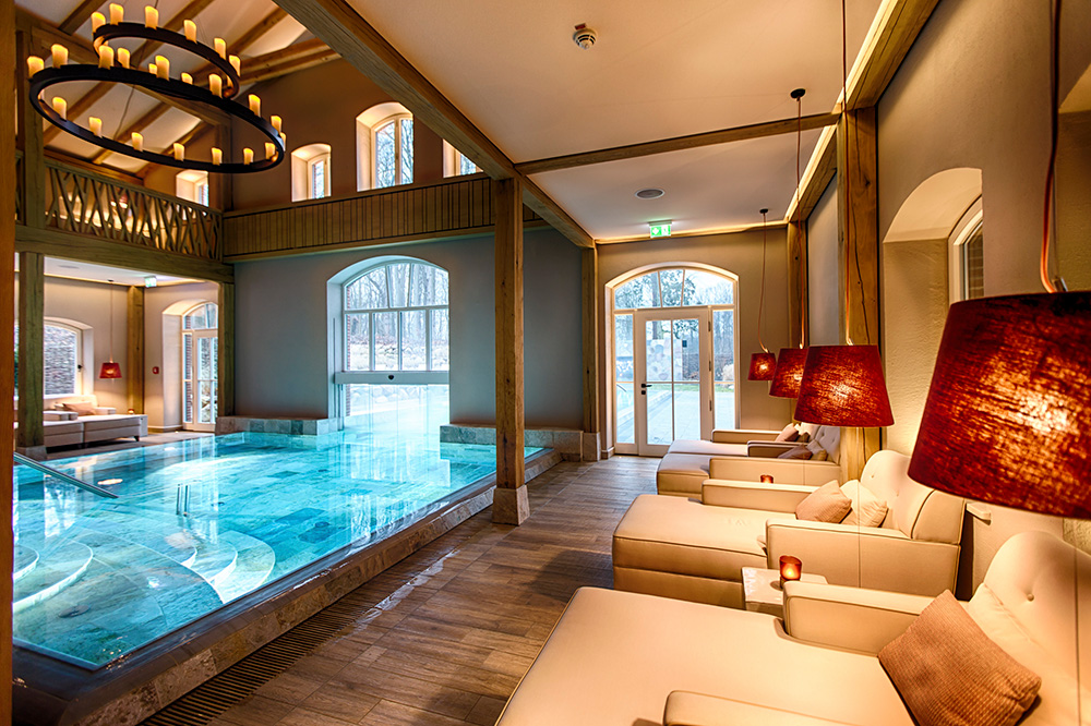 The indoor pool of the spa at Weissenhaus Grand Village Resort in Weissenhaus, Germany