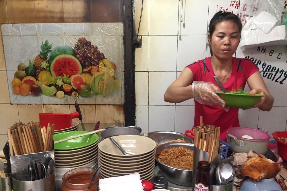 Hanoi street vendor whose family has had the same stall for 33 years - Kristen Remeza