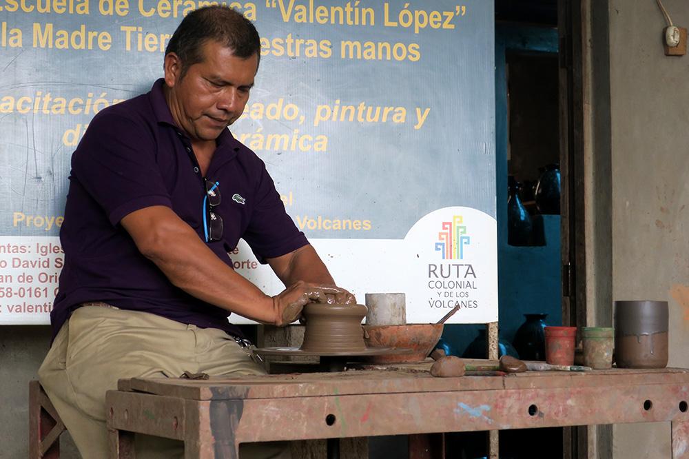 A pottery wheel demonstration at Taller Escuela de Cerámica Valentín López in San Juan de Oriente, Nicaragua