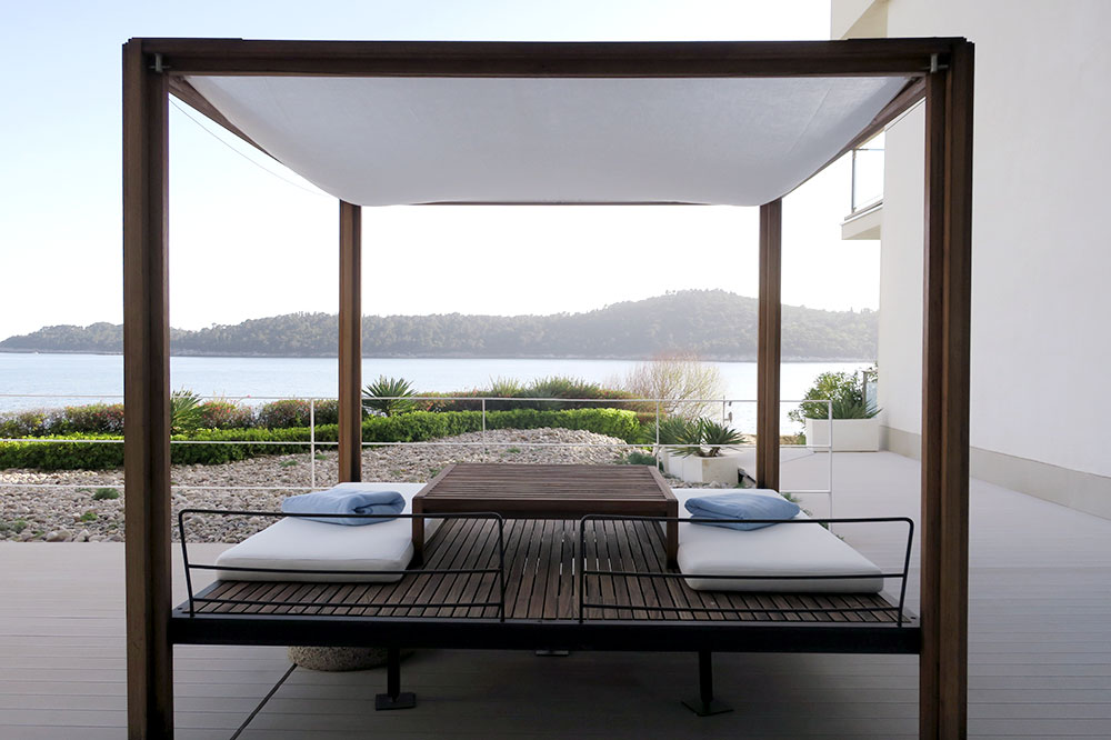A daybed on the terrace by the pool at Villa Dubrovnik