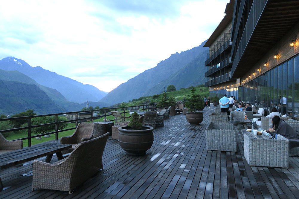 The terrace at sunset at Rooms Hotel Kazbegi