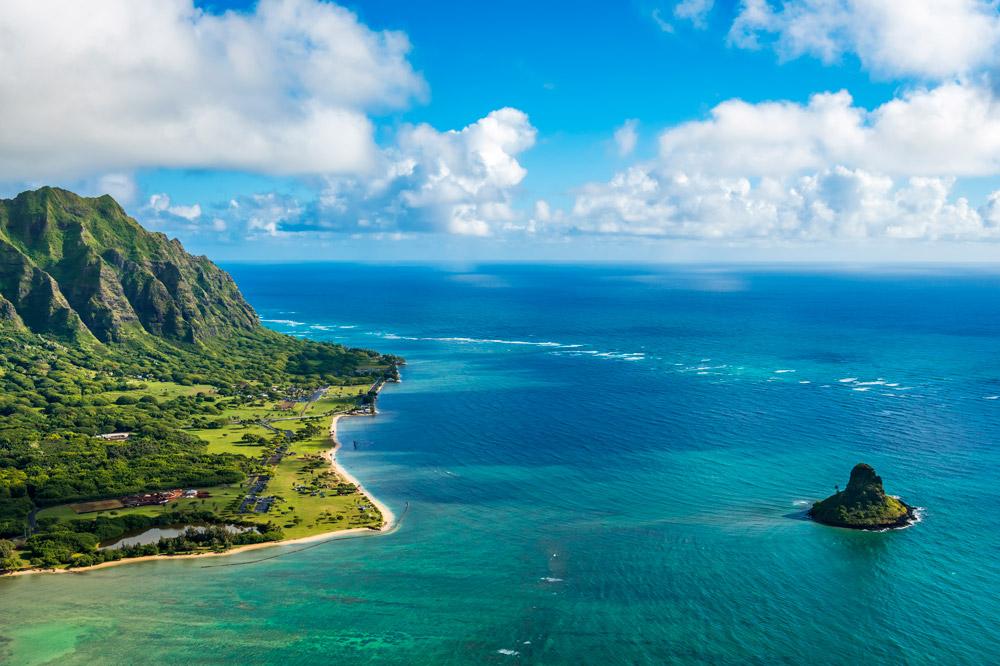 Aerial view of Kualoa Point and Chinamans Hat at Kaneohe Bay, Oahu
