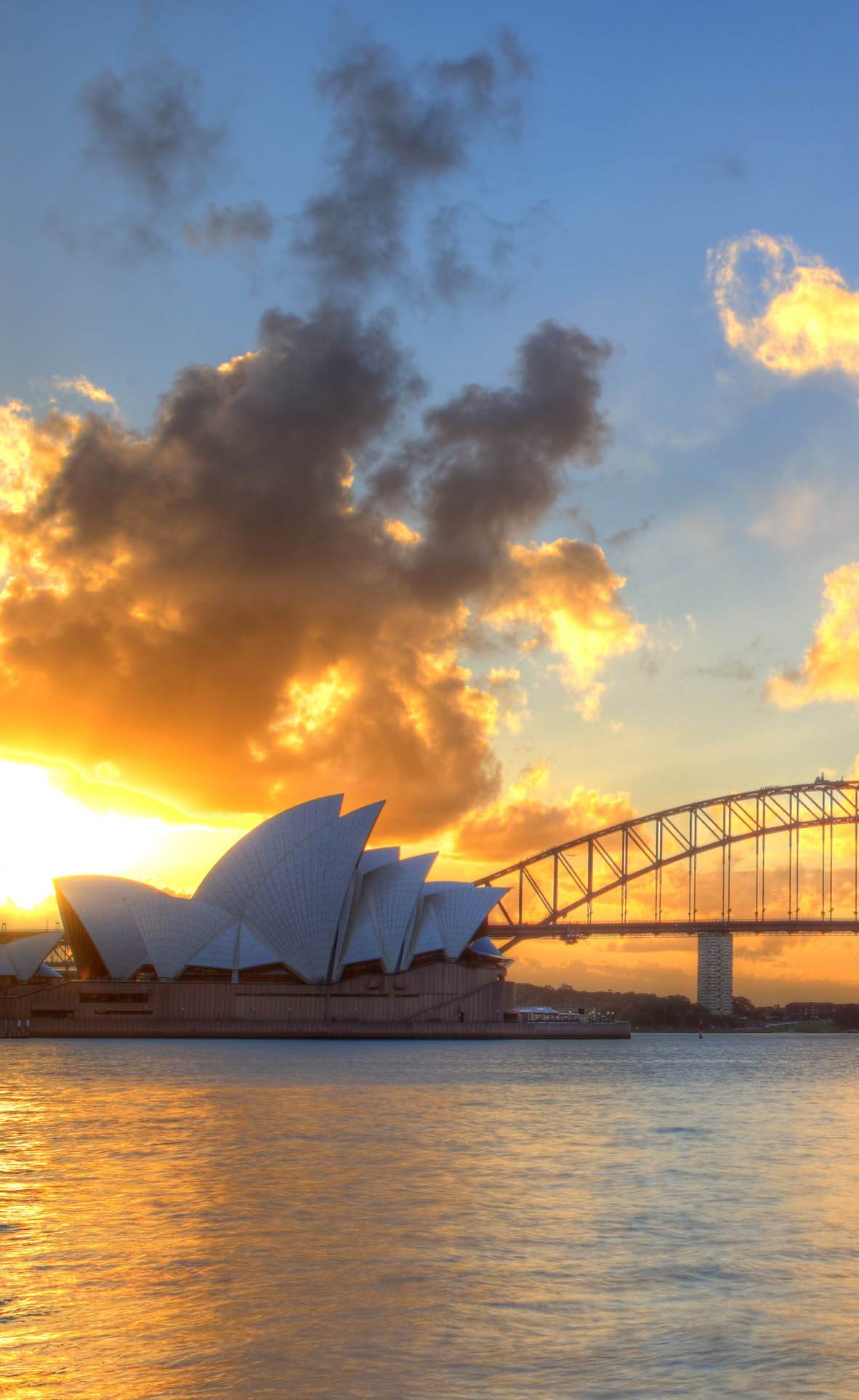 A view of Sydney Harbour with the Sydney Opera House and Harbour Bridge.