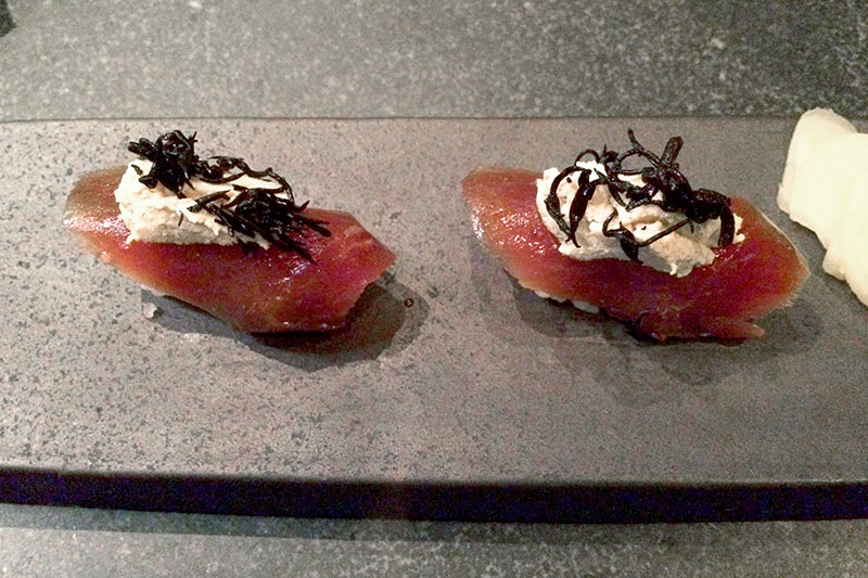 Slices of mackerel topped with a light peanut butter cream at <em>UNI</em> - Photo by Hideaway Report editor