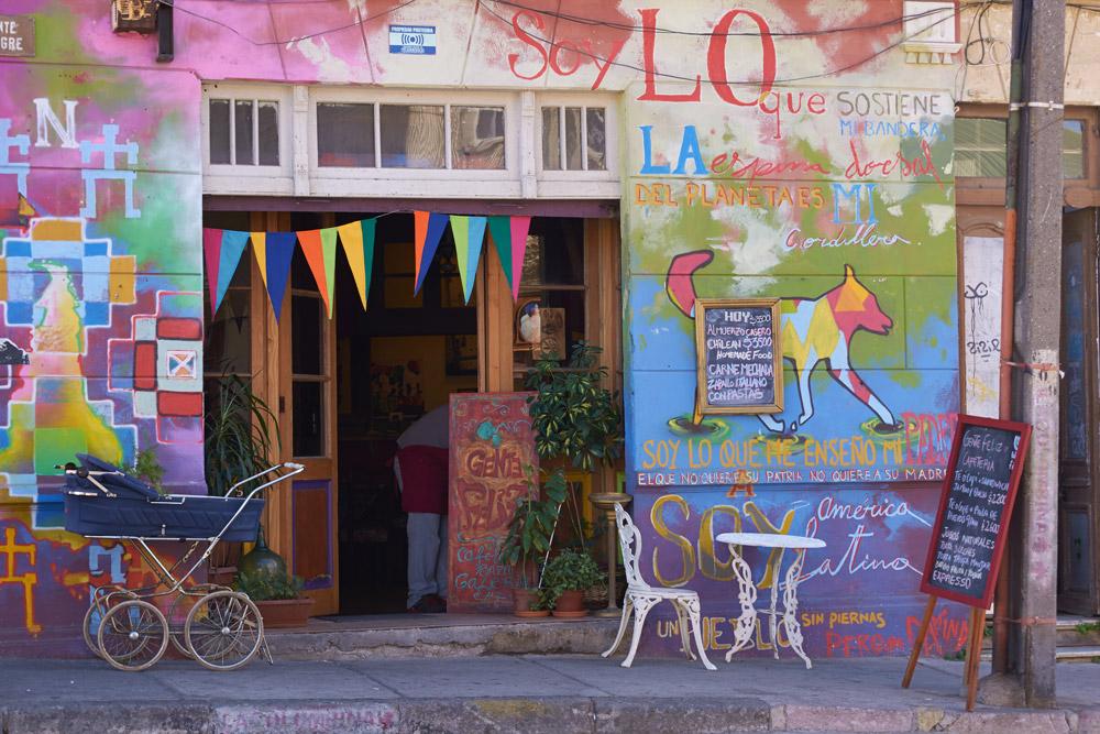Colorful murals decorating a café in Valparaíso