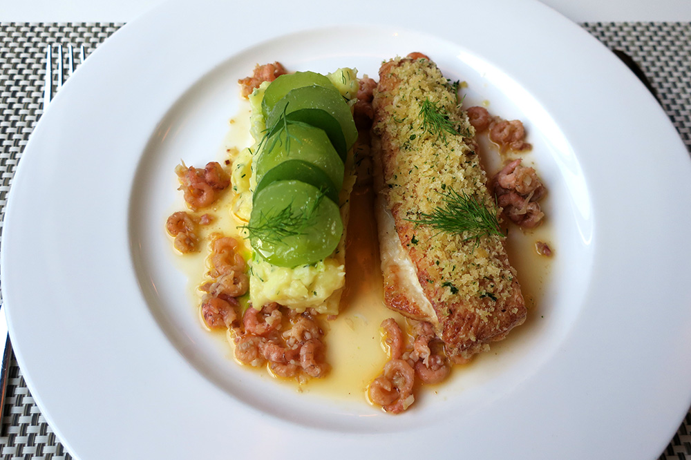 Finkenwerder-style plaice with crab cracklings, bacon gravy, cucumber salad and mashed potatoes with dill from <em>Restaurant VLET</em> in Hamburg, Germany - Photo by Hideaway Report editor