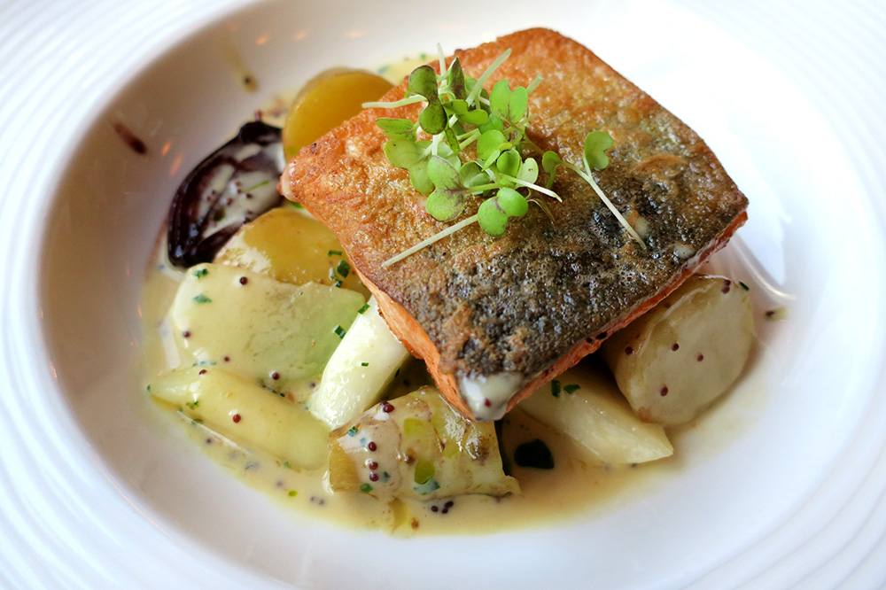 Traditional Pannfisch: arctic char in mustard sauce with tomatoes, turnips, carrots, beets and port-braised shallots from <em>Restaurant VLET</em> in Hamburg, Germany - Photo by Hideaway Report editor