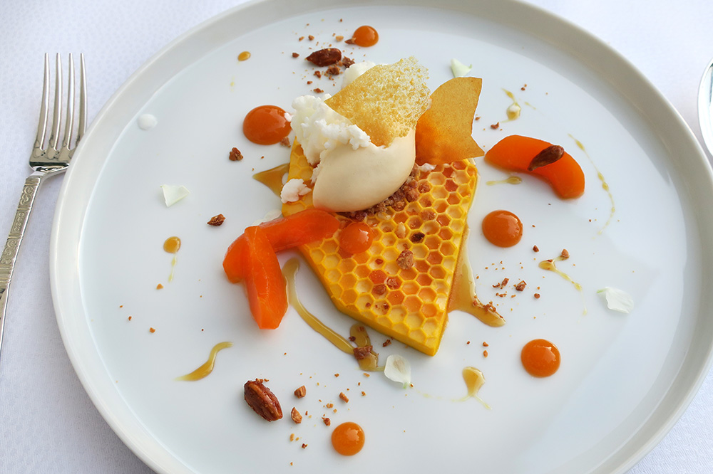 Honeycomb-shaped apricot mousse with apricot ice cream, almond-milk granite, fresh apricots and caramelized almonds from <em>Courtier</em> at Weissenhaus Grand Village Resort - Photo by Hideaway Report editor