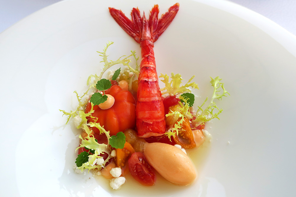 Carabineros prawn with tomato and cantaloupe sorbet on a base of pressed watermelon from <em>Courtier</em> at Weissenhaus Grand Village Resort in Weissenhaus, Germany - Photo by Hideaway Report editor