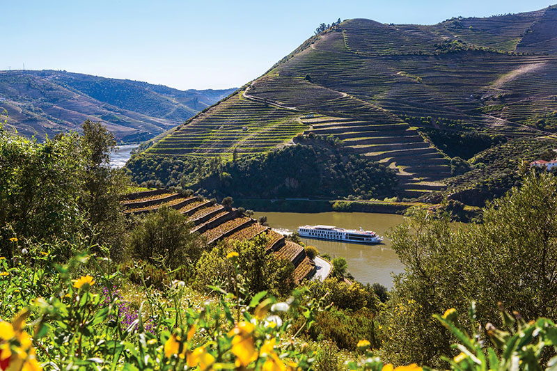 Uniworld's Queen Isabel cruising through the Duoro River Valley, Portugal