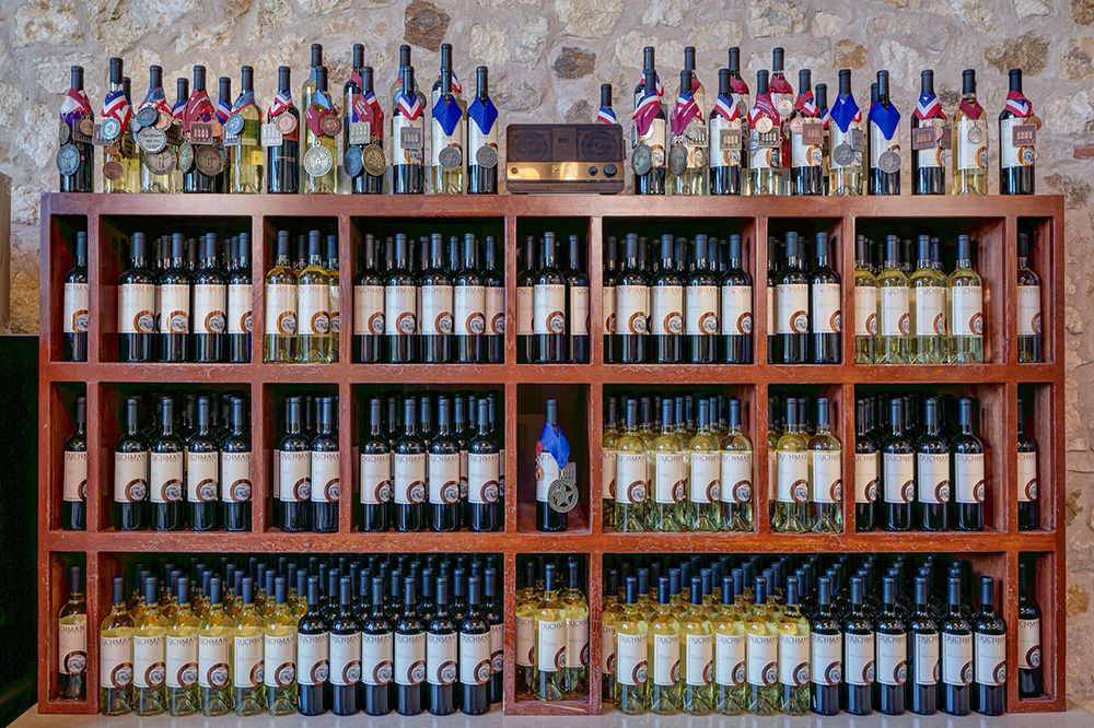 An assortment of wines displayed at Duchman Family Winery in Driftwood, Texas; the winery focuses on High Plains-grown Italians