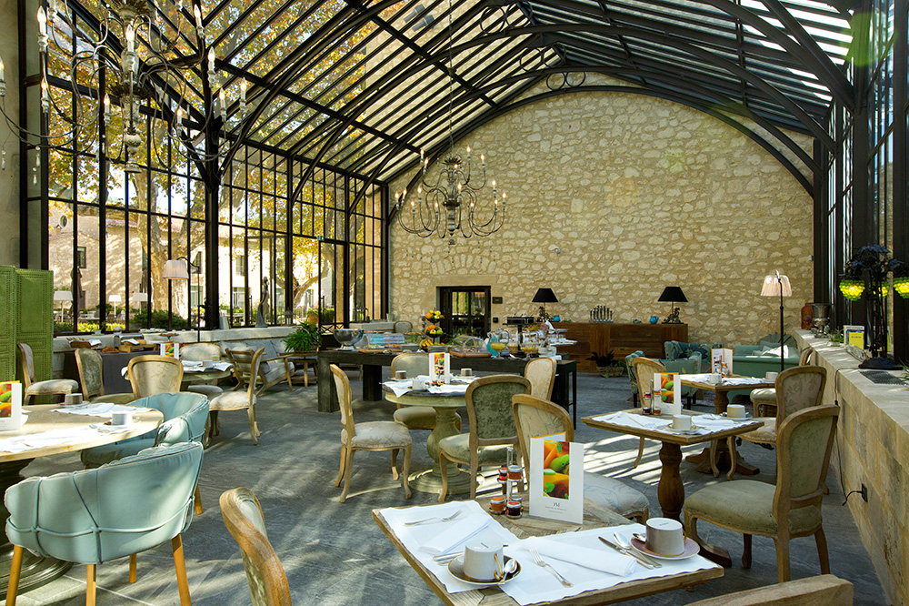 The Winter Garden, which acts as the breakfast room for guests, at Domaine de Manville in Les Baux-de-Provence, France