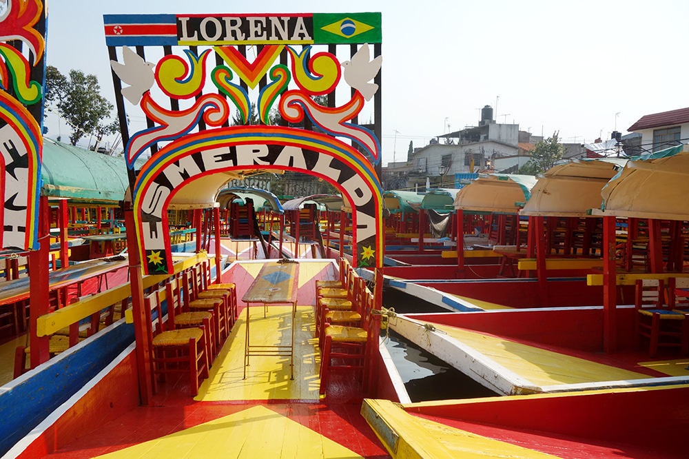 The colorful <em>trajineras</em> in the floating gardens of Xochimilco in Mexico City was an unexpected sight.