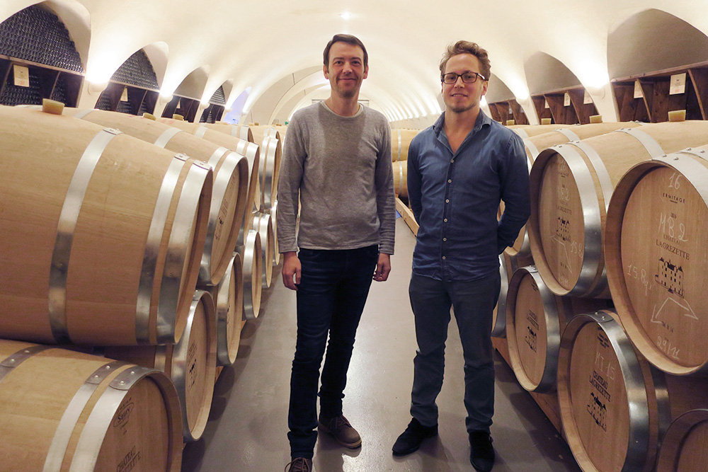 Yannick Druon, administrator of sales, and Arnaud Rodellec, intern, of Château Lagrézette in the winery's barrel room in Cahors, France - Photo by Hideaway Report editor